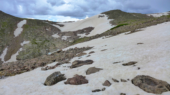Snowfield slopes down into chasm to the left. Sketchy.